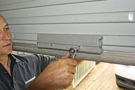 adding a weighted bar to a garage door handyman