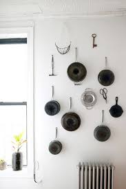 hanging pots and pans on wall v sanctuary