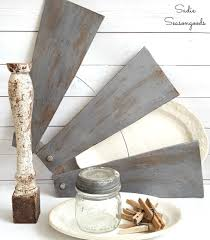 ceiling fan blades. windmill wall decor using ceiling fan blades