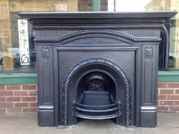 original antique victorian cast iron fireplace surround with cast arched insert