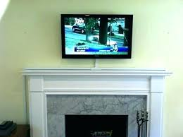 hiding tv wires over fireplace ideas to hide wires hang over fireplace mounting above brick fireplace