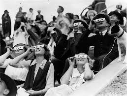 Image result for people wearing solar eclipse glasses