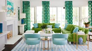 Though blue is a major player in this living room, the bold green couches  steal
