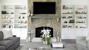 gray living room with built in shelves flanking fireplace