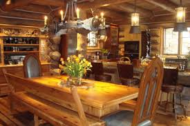 image of breathtaking small log cabin design ideas with black wrought iron chandelier lighting cabin lighting ideas