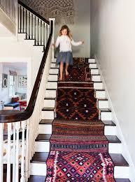 fabulous corner runner rug with styling tips layering rugs 4 ways erika brechtel