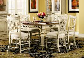 summerglen 7 piece oval leg dining table with spindle back chairs in two tone off white