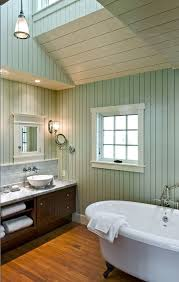 beach style bathroom. Painted Paneling For A Beach Style Bathroom With Wood Ceiling And By Whitten Architects G