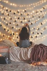 hang pictures on the string lights to create an enchanting photo