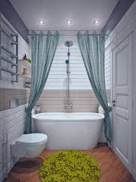 a center parted shower curtain makes a theatrical centerpiece of the bath tub and shower