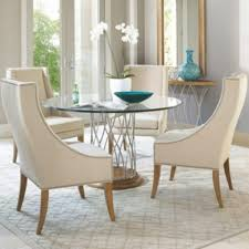impressive white leather wing back chairs and sleek round glass
