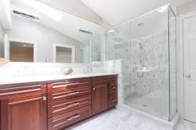 bathroom design center 3. Cherry Wood Double Vanity, Glass Shower Enclosure With Calacatta Gold Tile Bathroom Design Center 3