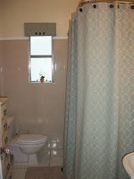 classic grey fabric extra long shower curtain liner with grey wall tile also small glass windows added white toilet in tiny bathroom ideas