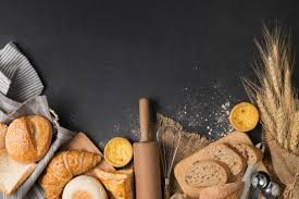 Bread And Bakery Ingredients On Black Stone Background Top View And
