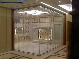 pooja room designs in glass