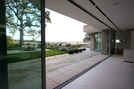 the flush floor track across the base of minimal windows merges inside and out