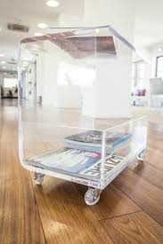 Clear acrylic side table with magazine rack. #design #designtrasparente # acrylic #plexiglass