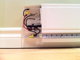 replacing standard electric baseboard heater linear convector note i mounted mine on a 14 mm thick piece of wood to space it out from the wall and to clear my short baseboard