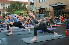 yogis take advane of a special outdoor vinyasa flow cl at hot yoga for life