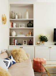 london apartment accessories with contemporary decorative pillows living room transitional and tufted orange ottoman