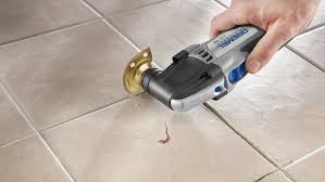 replacing grout between tiles and raking out tiles for regrouting diy doctor