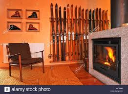 ski chalet furniture. chalet living room with inviting fireplace vintage ski rack and boots scandinavian furniture