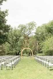 minimalist wooden circle wedding ceremony arch