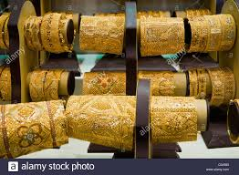 gold jewellery lined up in a window gold souk deira dubai united arab emirates