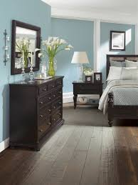 30+ Wood Flooring Ideas and Trends for Your Stunning Bedroom | Black  furniture, Moldings and Dark brown