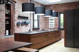 striking pendant lighting and brick walls create a great fusion between contemporary and industrial styles