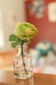impressive transpa mini bottle square bottom glass bud vase combined with little green rose flower decoration