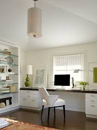 Large white office desk Modern White Office With Dark Floors Large Desk Under Window And Glass Bookshelves The Carriage House By Butler Armsden Architects Leechone White Office With Dark Floors Large Desk Under Window And Glass