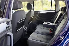 the tiguan has a fold down armrest with cupholders bottle holders in all four doors image credit matt campbell