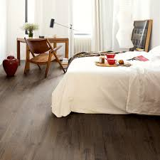 quick step impressive ultra waterproof laminate floor classic oak brown imu1849 this classic brown oak is the perfect floor for a warm and cosy feeling in