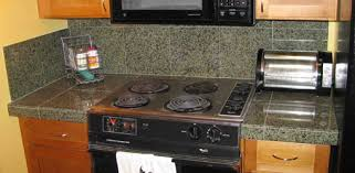 finished granite tile countertop around stove