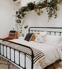 black bed with white furniture. black bed with a row of plants white furniture b