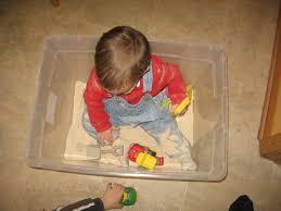 baby playing in sandbox