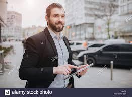Use Tablet As Phone Man Phone Pc Tablet Multitasking Stock Photos Man Phone Pc