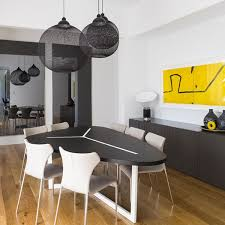contemporary interior design dining room with oval table and globe mesh pendant lights by australian interior