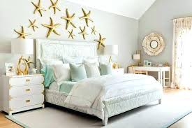 contemporary beach cottage bedroom with gold starfish wall decor mint green and c bedding crib canada