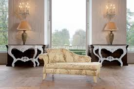 furniture cream fabric sofa bed with white wooden legs added by twin cream table lamps