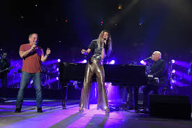 our review of billy joel s latest madison square garden gig which featured the piano man singing with special guests miley cyrus and paul simon