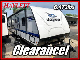 0 clearance 1 travel trailer age new bath direct entry door bath tub bed queen bed walkaround bedroom front bunks rear bunks private