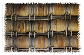 stacked oak barrels maturing red wine. Wine Barrels - Stacked.adj Stacked Oak Maturing Red