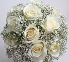 handtied posy bouquet of ivory roses and delicate gypsophila flowers bridesmaid flowers