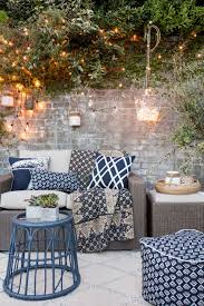 string lights don t always have to steal the show d them across some plants or a wall adds a lovely but subtle background touch to your outdoor