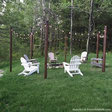 diy outdoor lighting. DIY Easy Outdoor String Lighting Posts Around A Fire Pit And Seating Area, Featured On Diy E