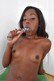 Ebony with shaved pussy masturbating