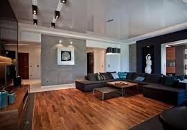 Living room flooring Grey Wood Flooring Is The Best Friend Of The Cozy And Modern Interior Since It Brings Warm Character And Sets Solid Foundation In The Living Room Rilane Living Room Flooring Useful Solutions And Superb Design Ideas Rilane