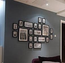 black picture frames wall. I Also Am Crazy About The Contrast Of Blue Walls And Black White Photos. Picture Frames Wall T